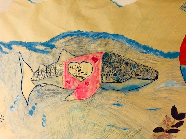Children's drawing of a whale that says save the sea ice