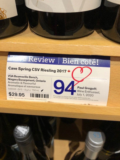 Shelf display showing Cave Spring CSV wine getting a 94 point rating