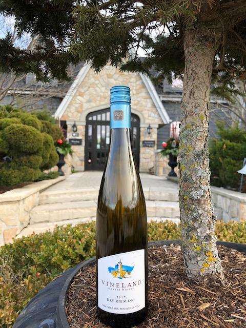 Vineland Estates Dry Riesling bottle in front of wine entrance