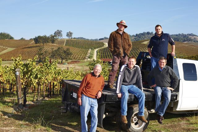 group shot of Tablas Creek vineyard owners