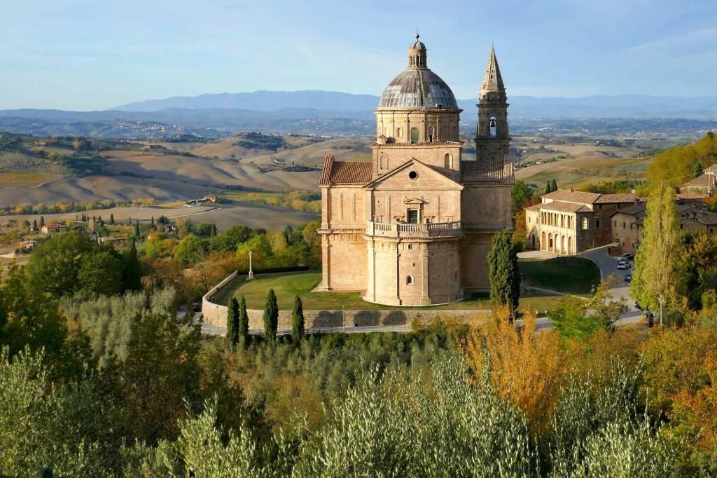 besutiful church in Montepulciano set against rolling hills of Montepulciano appelation