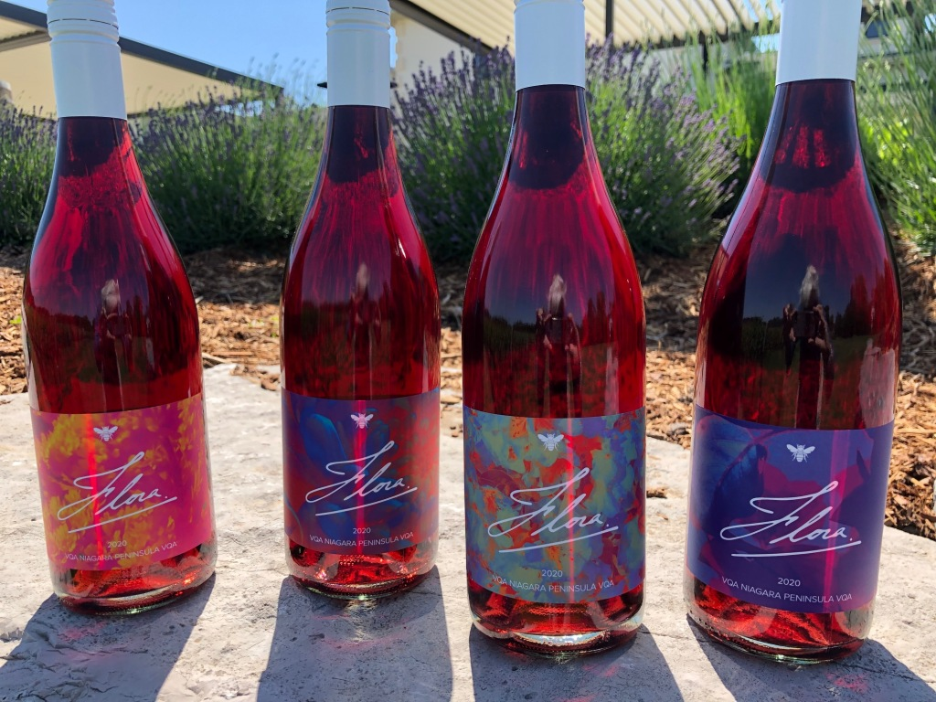 collection of 4 bright pink bottles of Flora wine