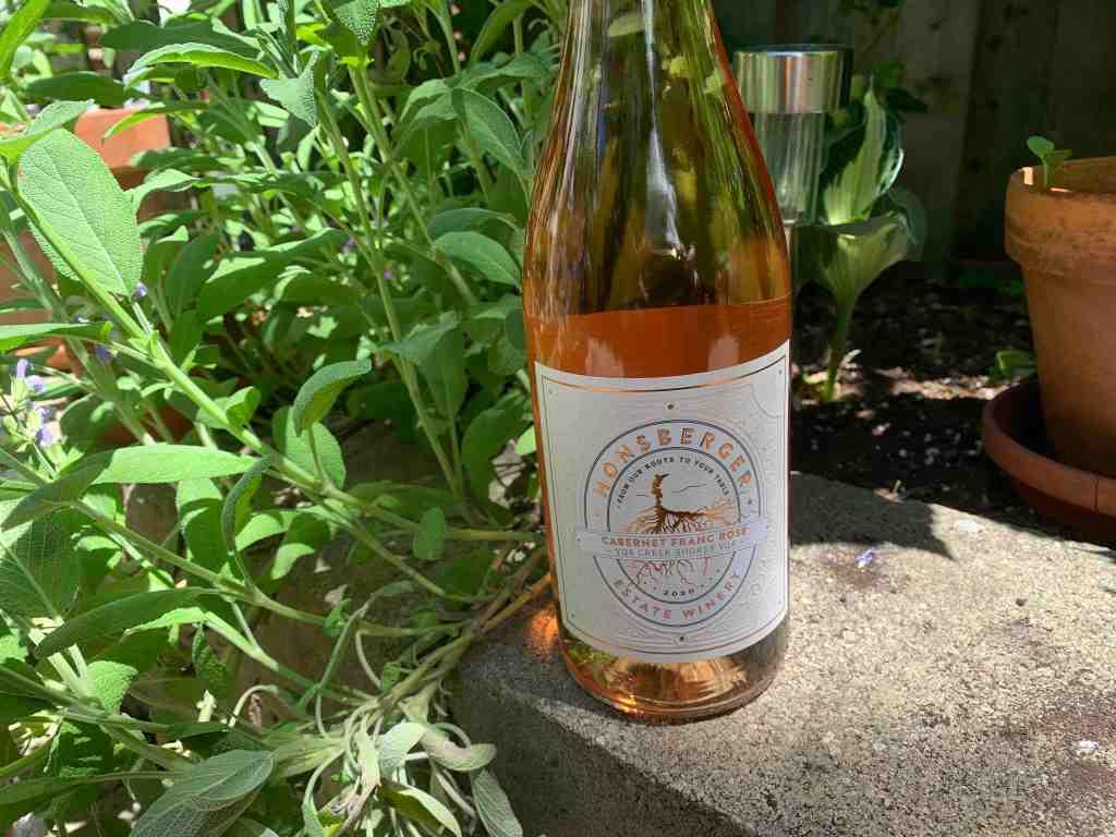 bottle of Honsberger wine sitting on garden ledge