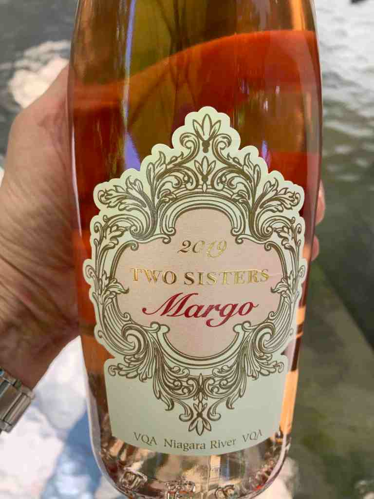 Bottle of Two Sisters wine called MArgo in darker pink